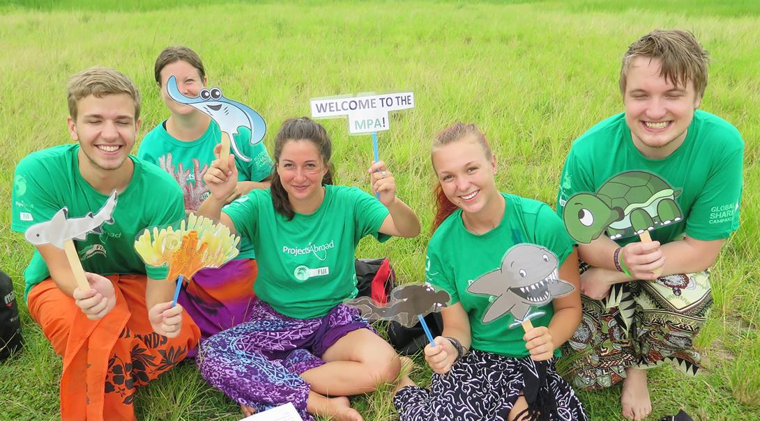 Projects Abroad Shark Conservation volunteers prepare material for an awareness campaign in Fiji.